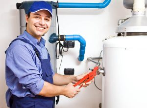 bigstock-Smiling-technician-repairing-a-36678109